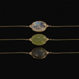 In total three bracelets. All consist of labradorite and diamonds (14KT gold)