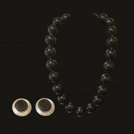 the necklace consists of round cut onyx and silver lock_the ear tops consist of onyx and silver