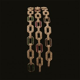 in total three bracelets. one set with sapphires and diamonds, one set with rubies and diamonds and one set with emeralds and di