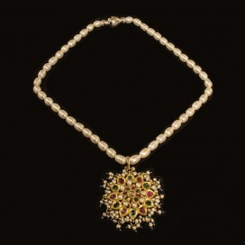 A Mughal pedant set with emeralds, rubies and white sapphire