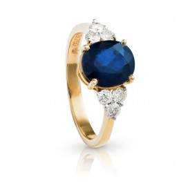 Ring 18kt Yellow gold set with a blue sapphire and brilliants