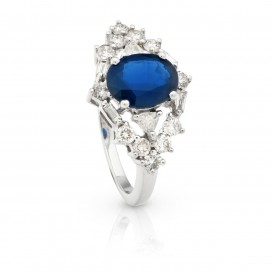 Ring 18kt White gold set with a blue sapphire and brilliants