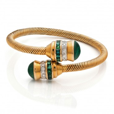 Bracelate 18kt Yellow gold set with cabochon and cut emeralds and brilliants