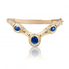 Bracelate 18kt Gold set with blue sapphires and brilliants