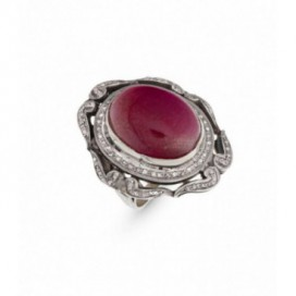 Art deco (1925) silver and gold polished ring set with old cut diamonds and a cabochon ruby