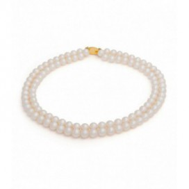 Two strings of Oriental round pearls. 14kt gold lock