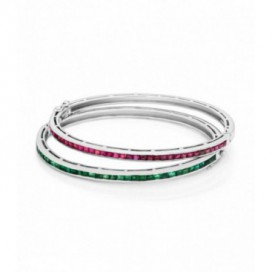 Silver bracelets set with rubies and emeralds.