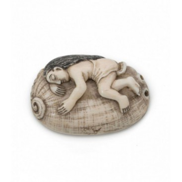 Man resting on shell netsuke