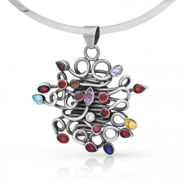 Solid silver pendant set with garnets, citrine, blue topaz, iolite and amethyst