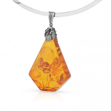 Silver pendants set with a big amber