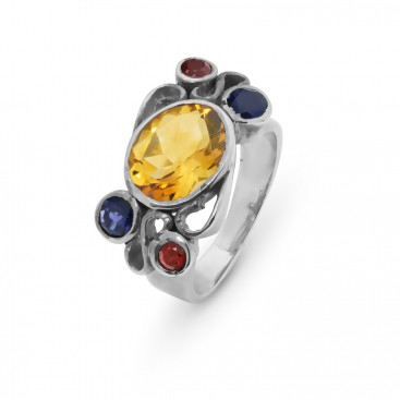 Silver ring set with a citrine, garnets and iolites
