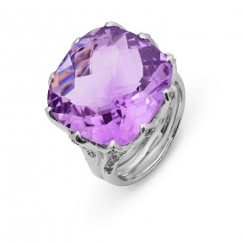 Silver ring set with a briolette cut amethyst and white sapphires all around