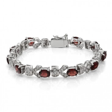 Silver bracelet set with garnets and crystals